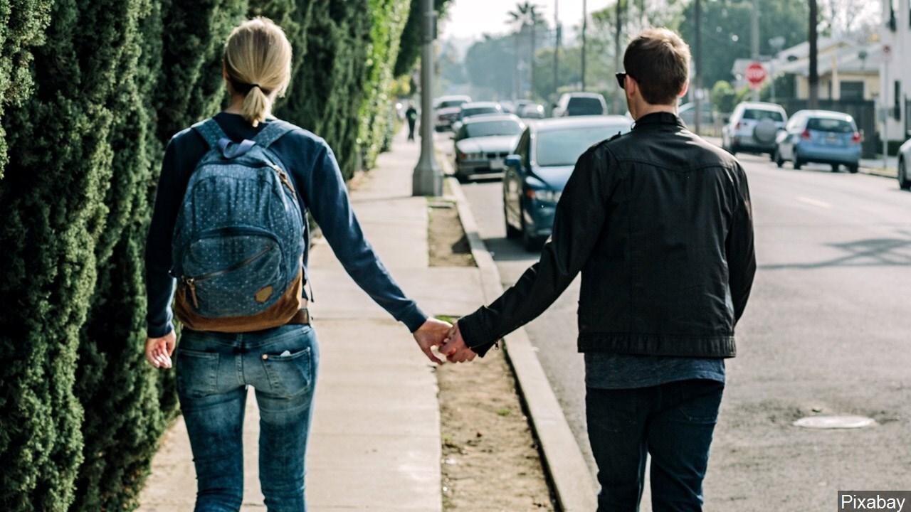 Teen couple holding hands.jpg