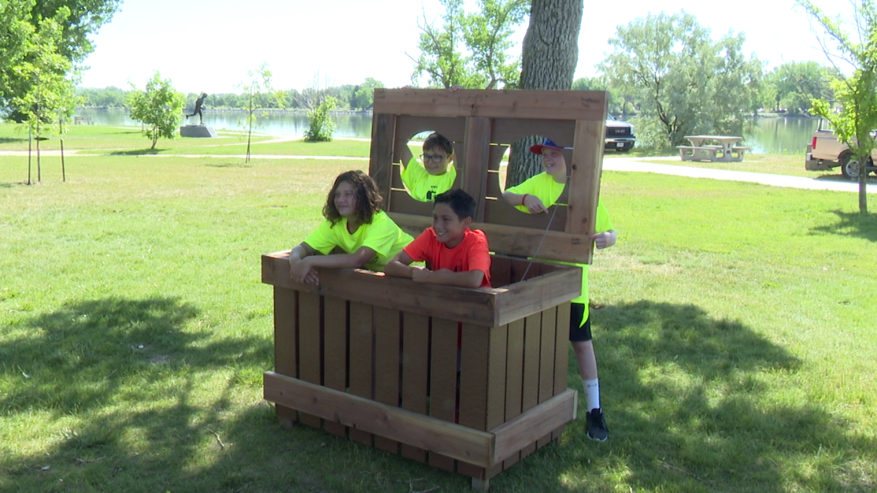 Students build trash bin containers for River's Edge Trail