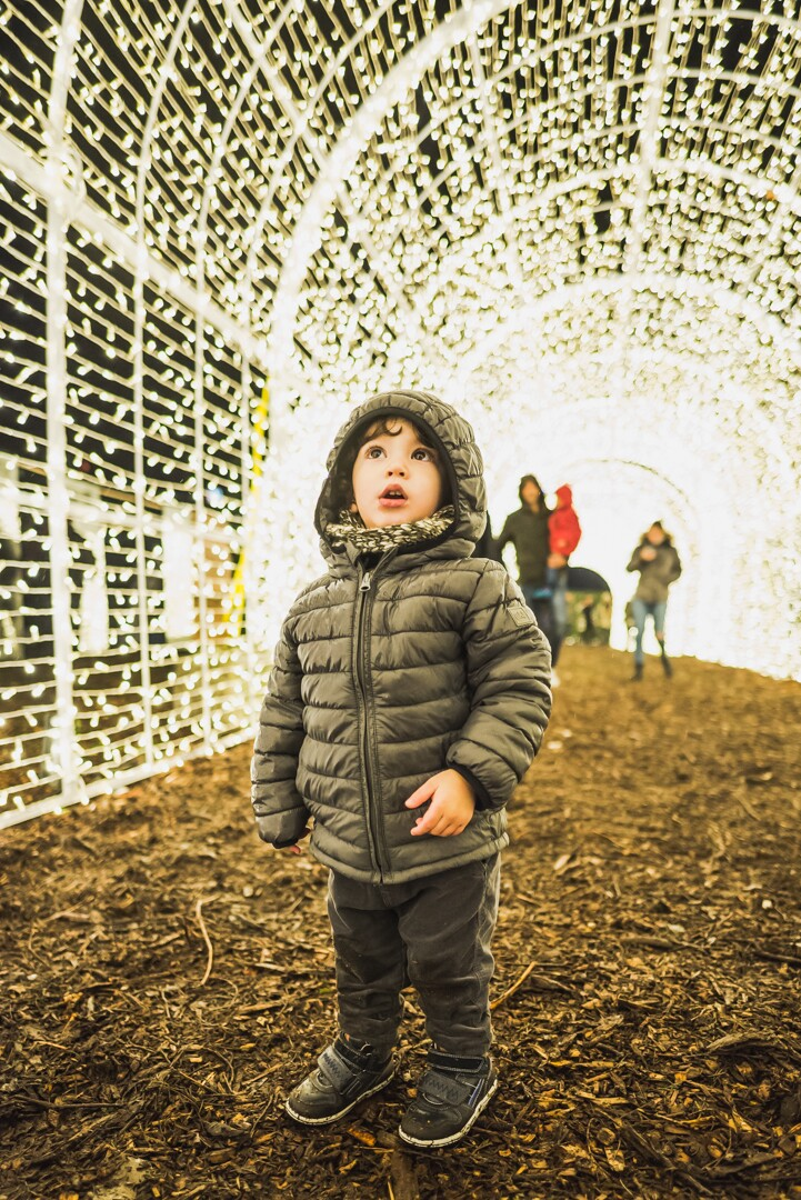 Enchant-Christmas-Boy-In-Light-Tunnel.jpg