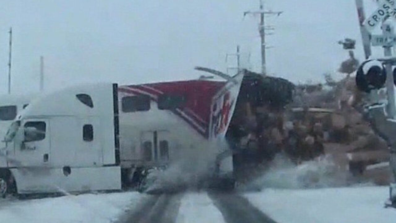 Video shows commuter train crash into semi truck, cutting it in half