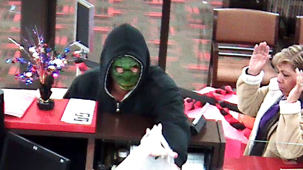 Police release images of armed bank robbery suspect, seek public's help to ID him
