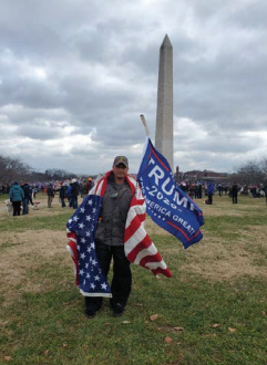 Michael Foy, 29, seen posing in front of the Washington Monument on January 6th. The photo was posted to his father, Joseph Foy's, Facebook page and helped the FBI identify Michael.