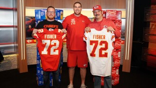Fans and Fisher with Signed Jerseys.JPG