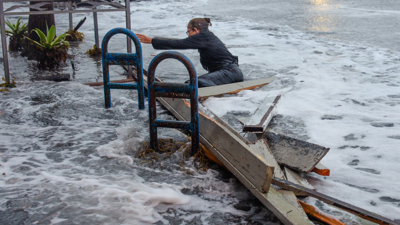 woman swept away high tide ocean beach surf  3