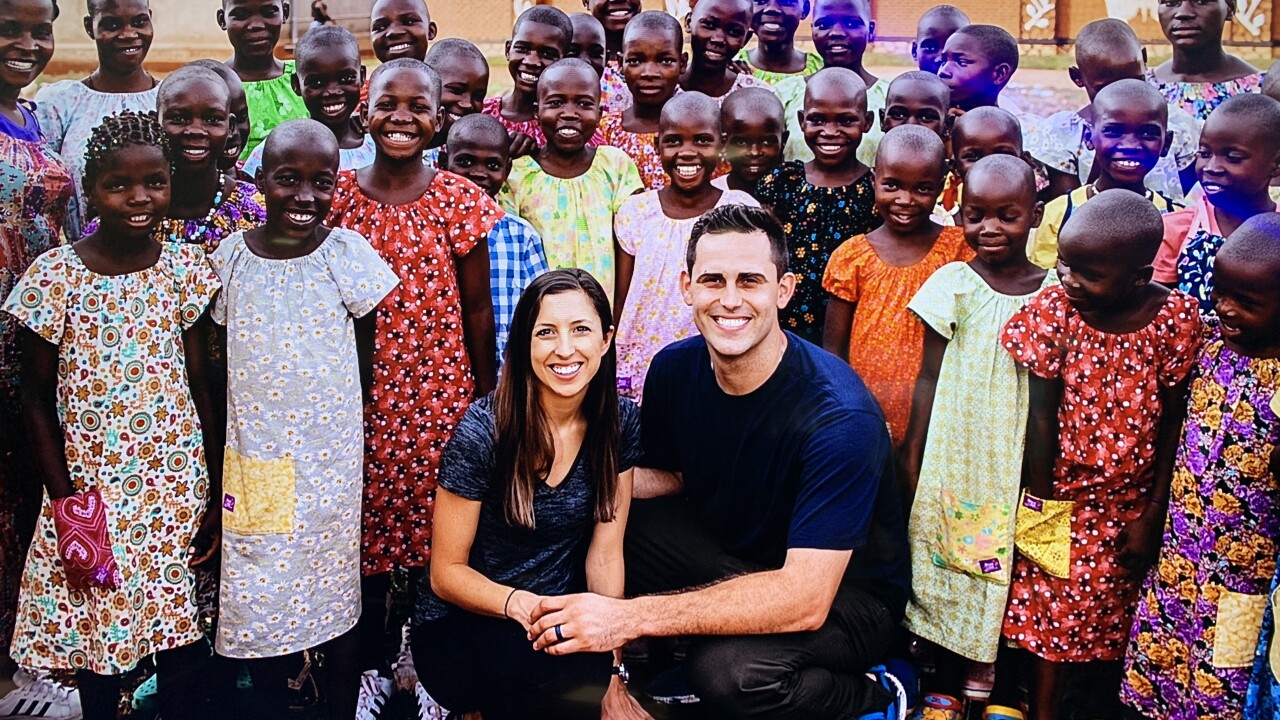 Boyd hosts Top Golf event with goal to build houses for children in Uganda