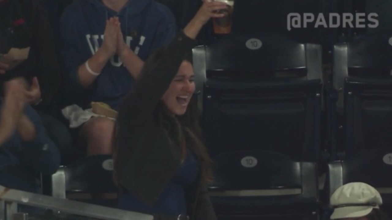 Fan catches foul ball in beer and finishes off her drink at Petco Park