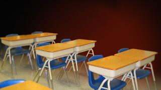 Empty school desks graphic