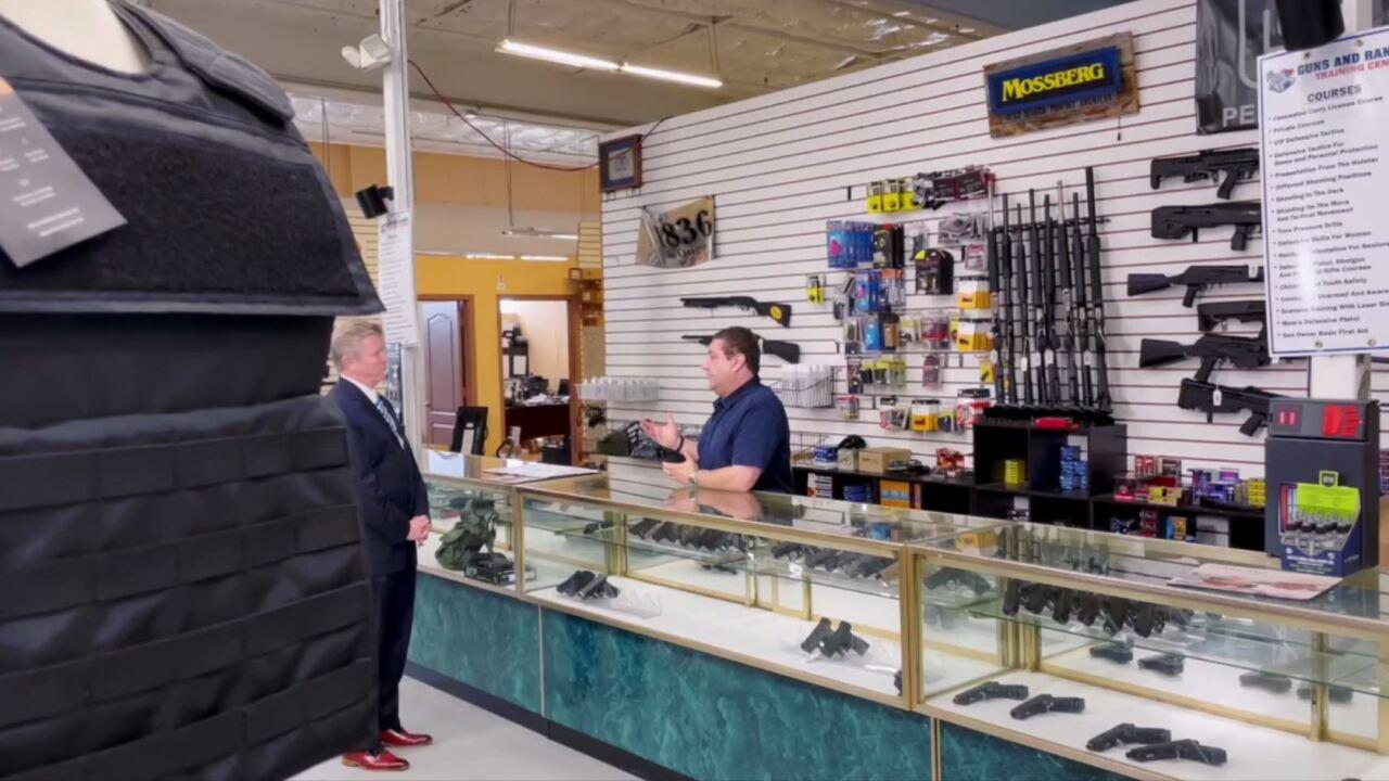Dave Bohman speaks with gun shop owner Alex Shkop