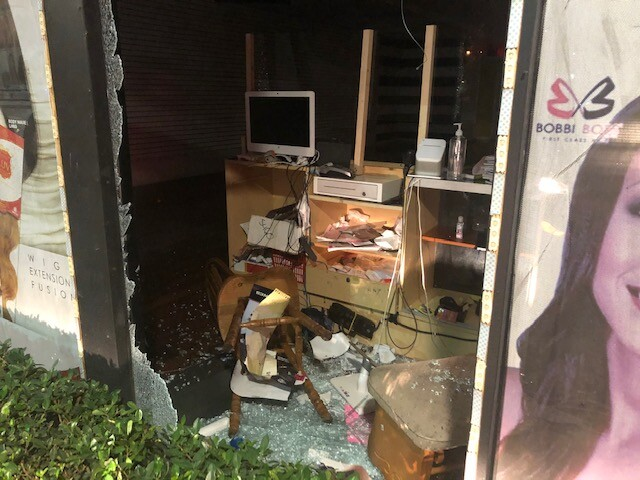 Storefront of beauty supply store damaged in West Palm Beach