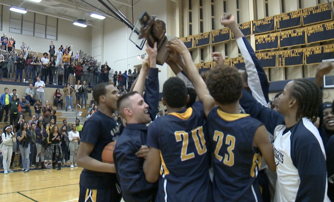 Godwin Heights celebrates the district championship after beating Wayland