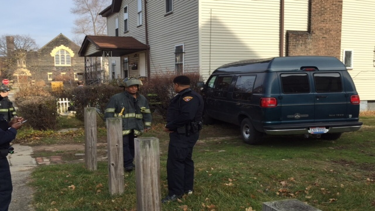 Van crashes into two homes on East 84th Street