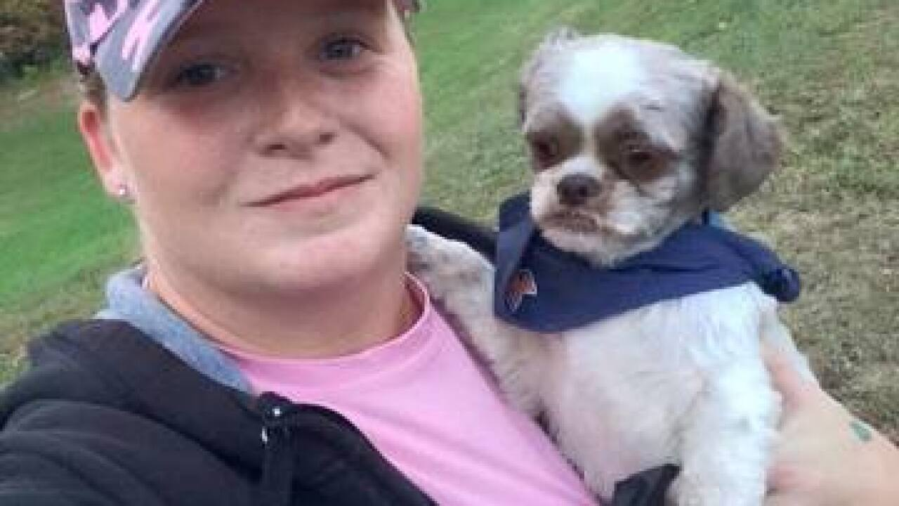 Woman pleads for return of stolen dog