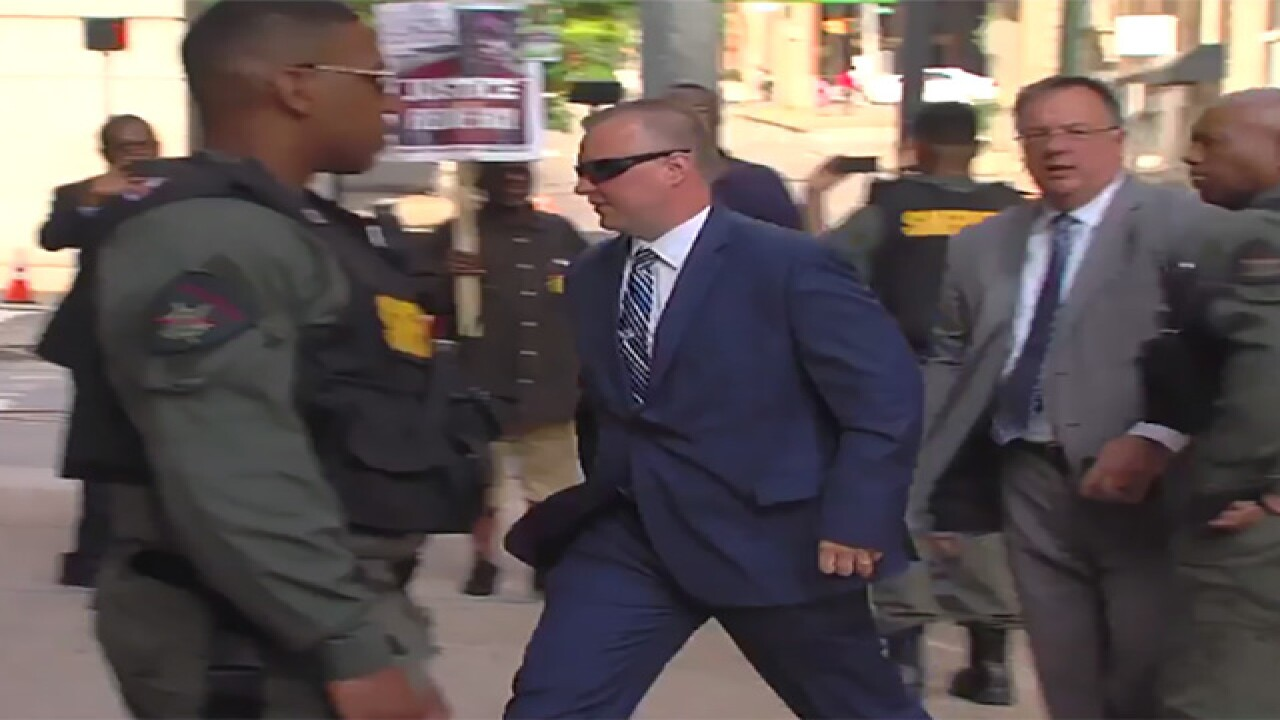 Charges dropped against officer in Gray case