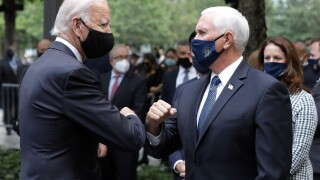 Biden, Pence greet each other with elbow bump as they cross paths at 9/11 event