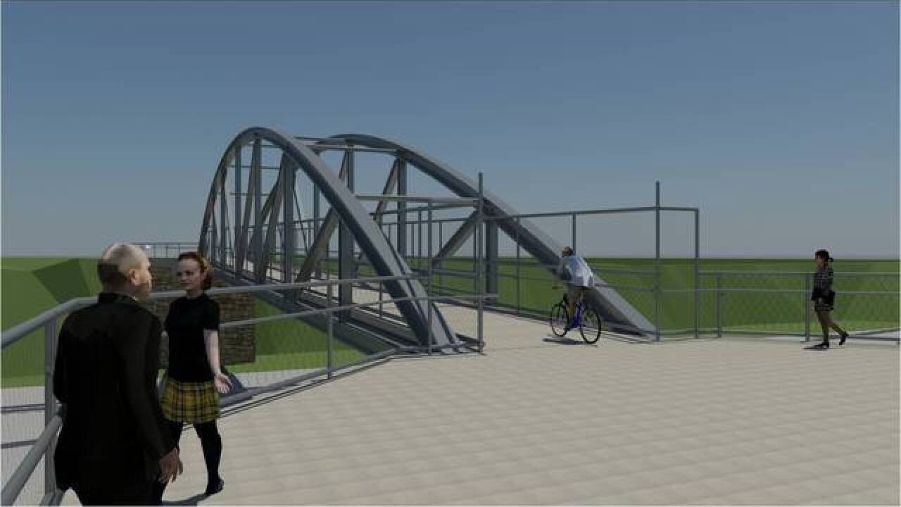 Pedestrian bridge going up over I-190 Saturday