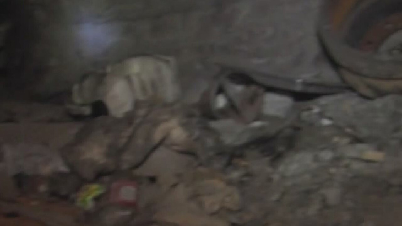 Kids found in crate underground, mom charged