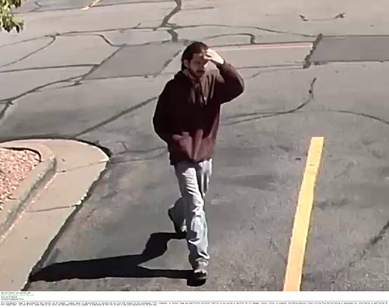 Photos: Police and the FBI are looking for man who robbed Key Bank at Olympus Hills Mall