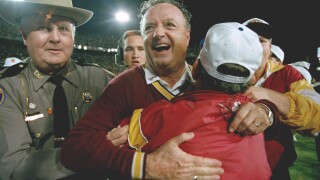 Florida State Seminoles head coach Bobby Bowden hugged after beating Nebraska in Orange Bowl to win 1993 national championship