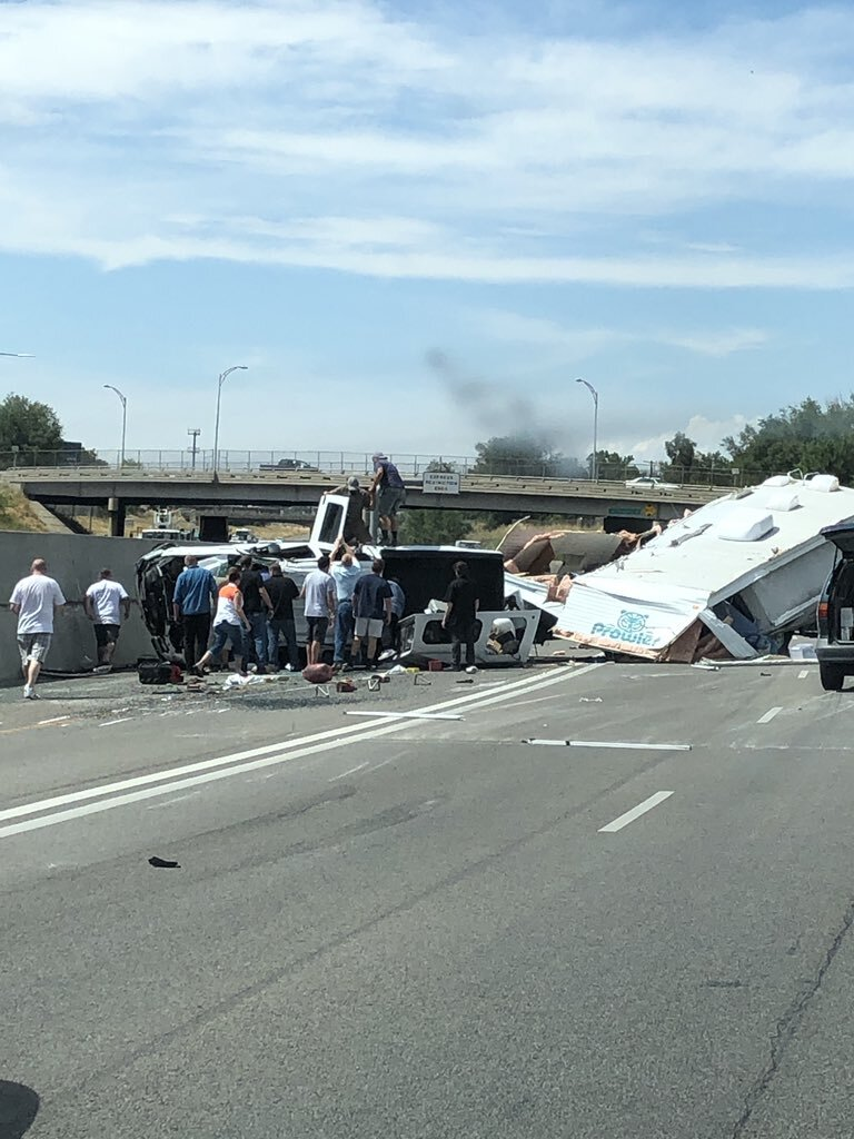 Photos: Truck and trailer rollover closes northbound I-15 lanes near LaytonParkway