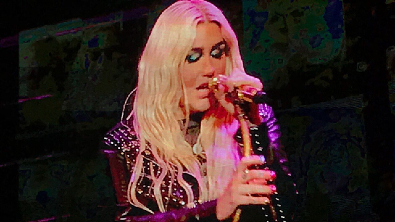 Kesha cries during performance of 'Praying' as fans hold up thank you notes