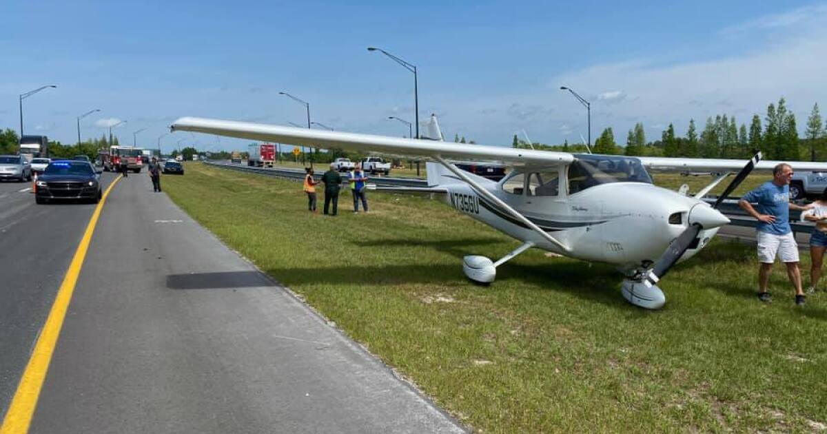 Small plane lands on grass shoulder of Polk Parkway