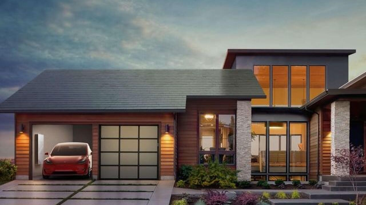 Tesla starts selling solar roof tiles; says savings to cover costs