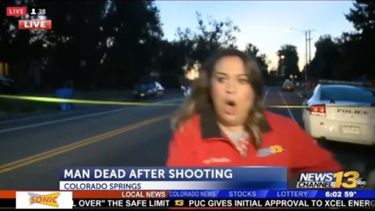 KRDO crew almost hit by car at crime scene