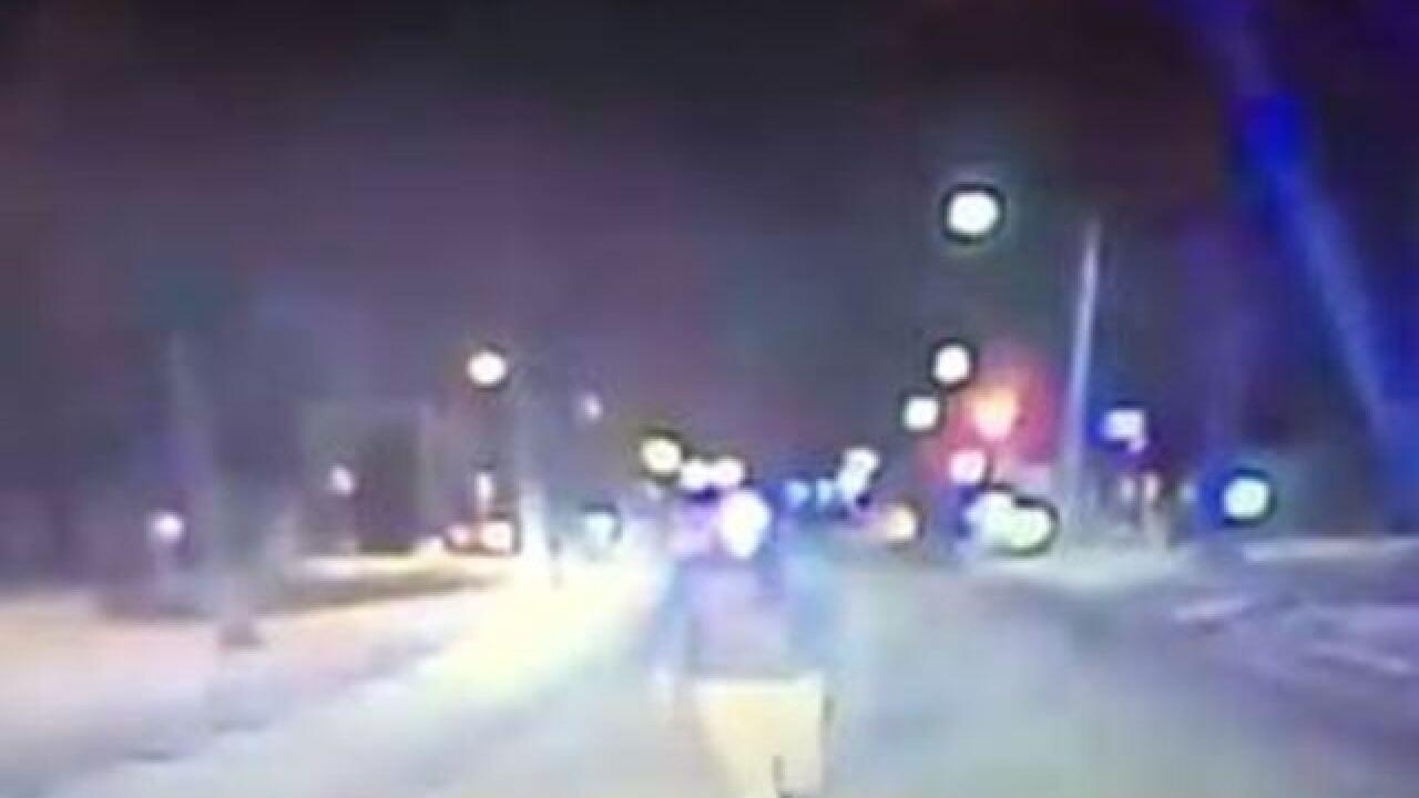 WATCH: Wisconsin man belly-flops onto cop car