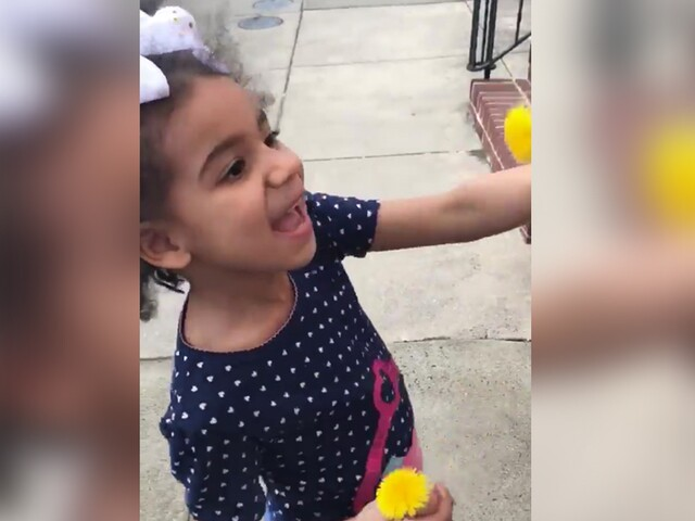 Baltimore girl spread love with flowers