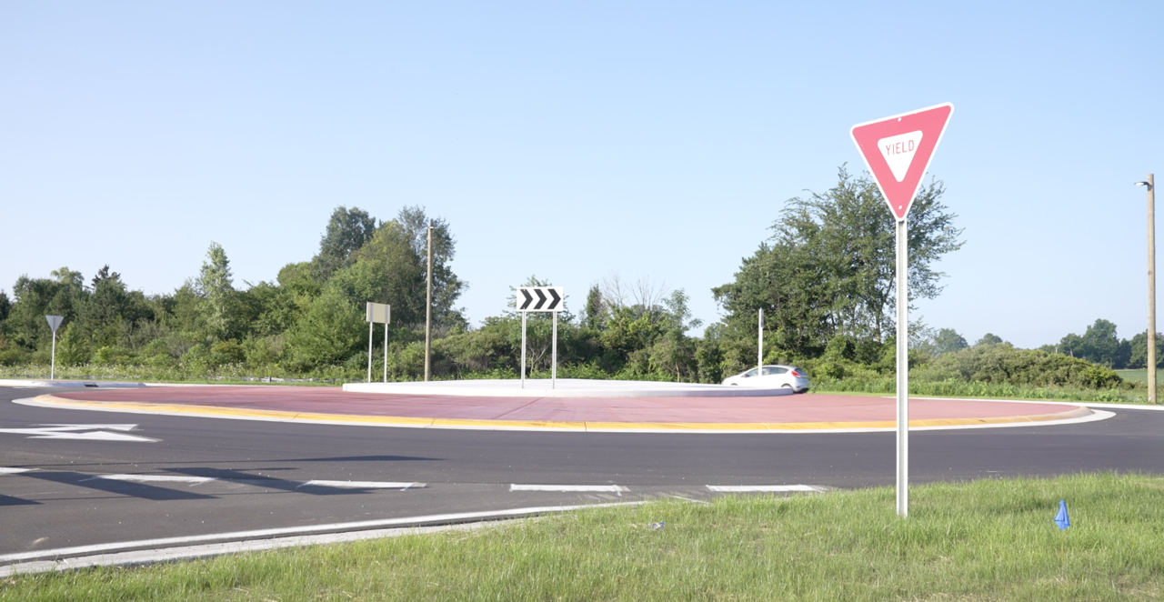 A car is going through the roundabout