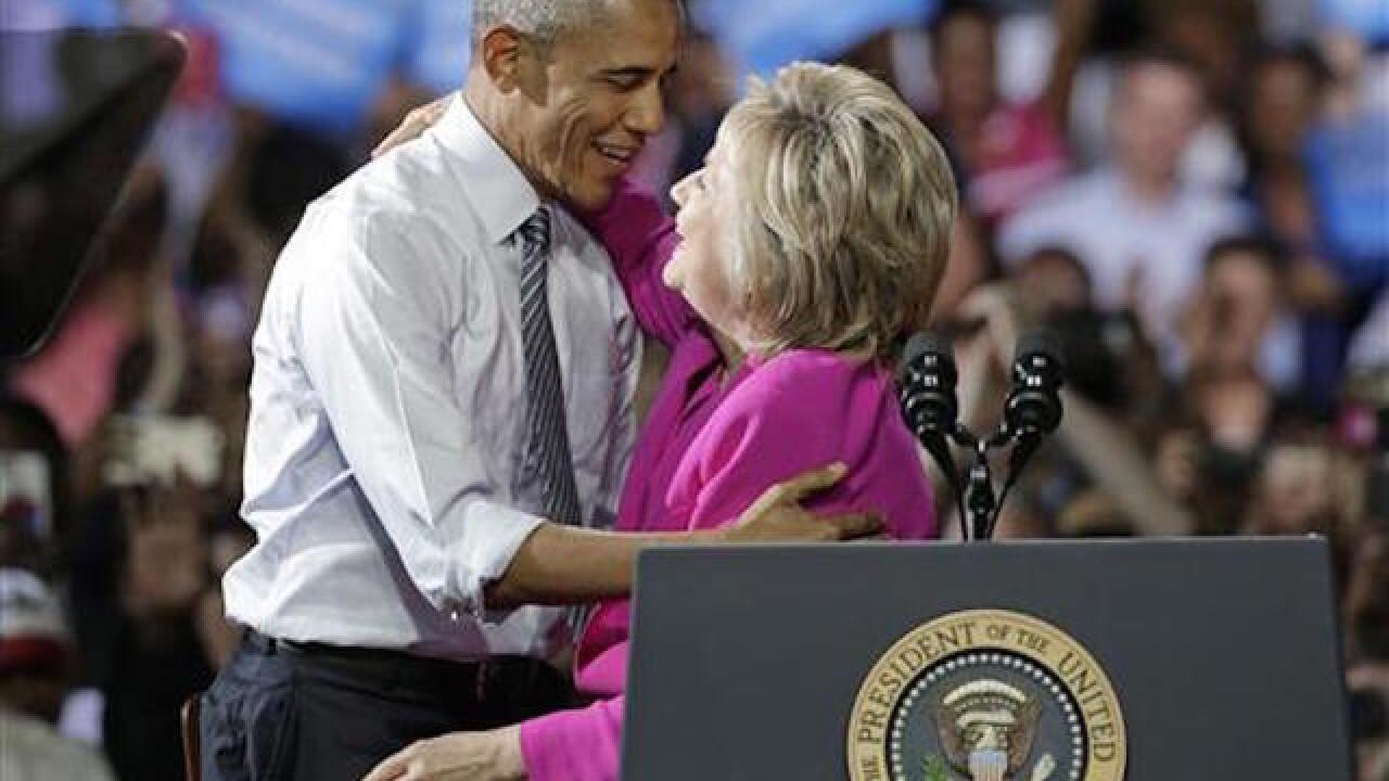 Obama makes first campaign appearance with Hillary Clinton