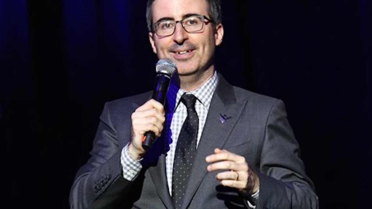 John Oliver buys, forgives $15 million in debt