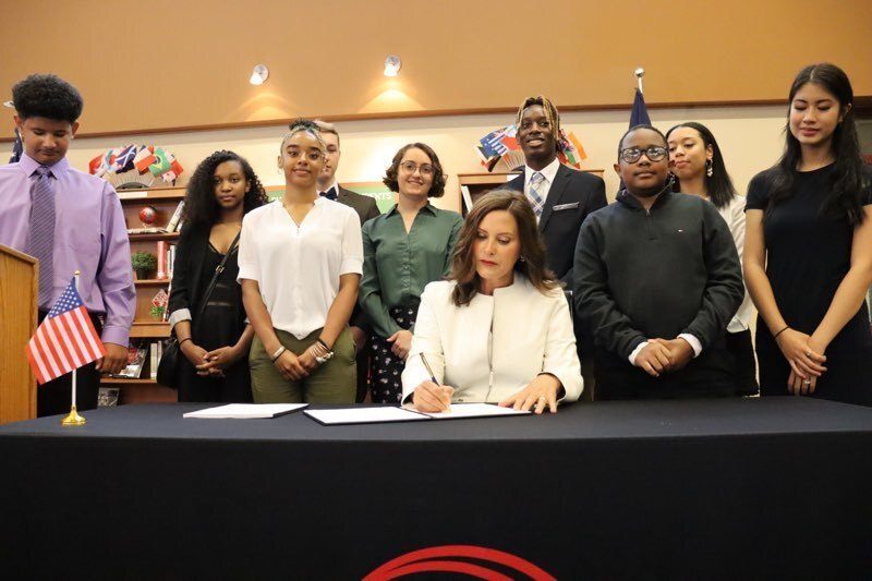 Governor Whitmer signing a K-12 funding bill