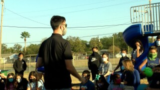 Director Garner Burford speaks to the students at West Side Helping Hand