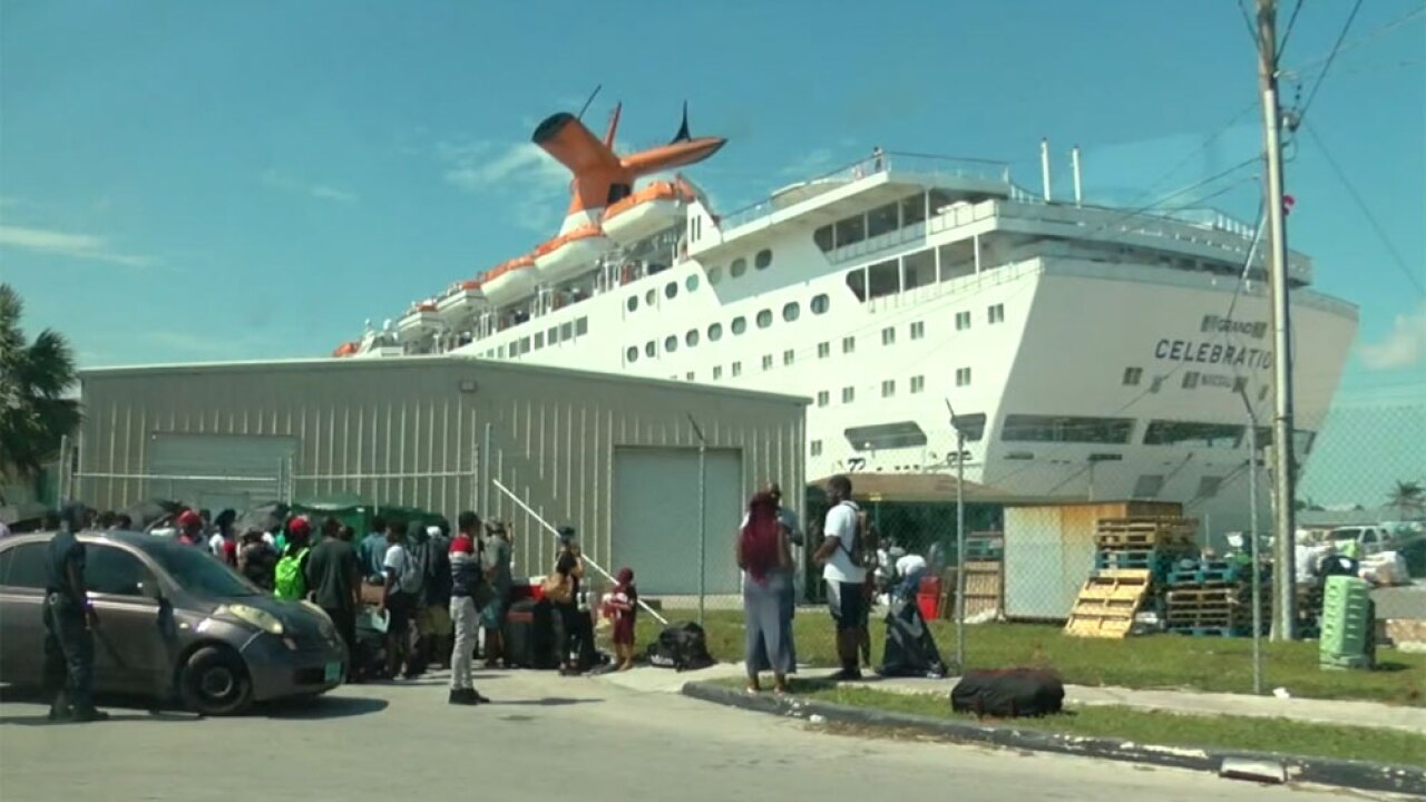 Volunteers bring supplies to victims of Hurricane Dorian on Bahamas Paradise Cruise Line ship