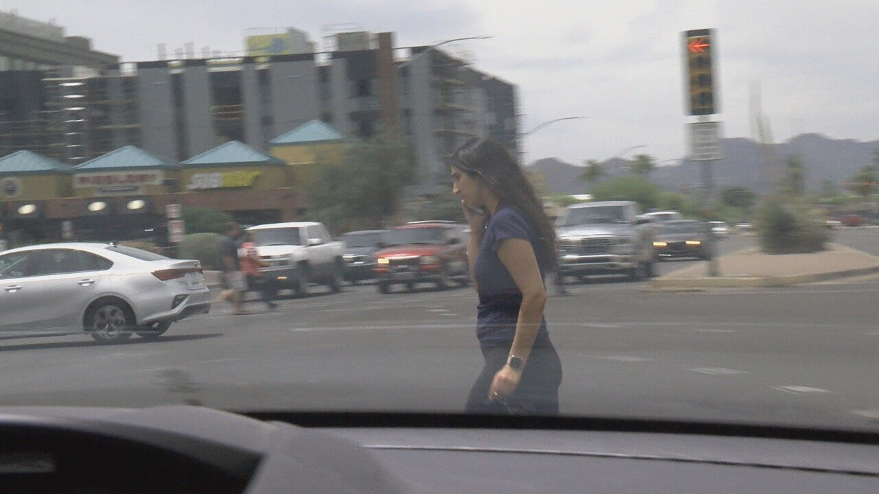2019-05-23 Jaywalking school-woman crossing speedway.jpg