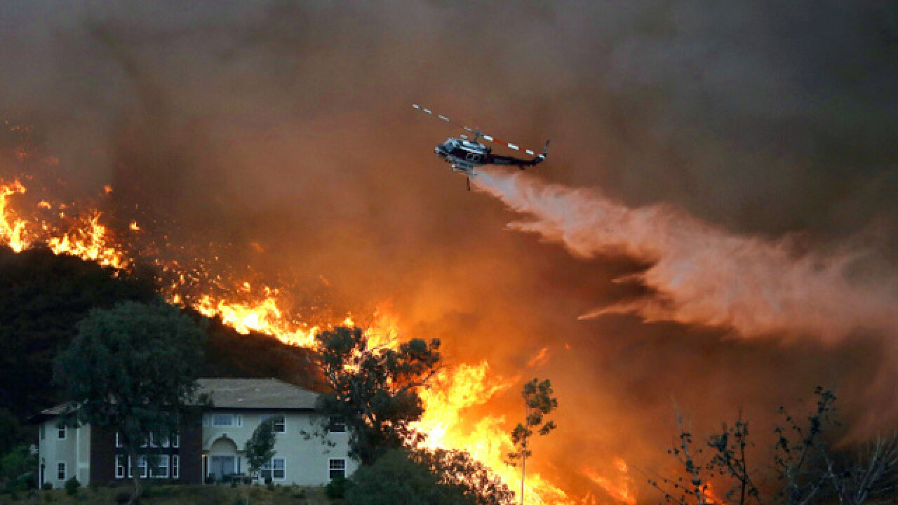 Over 20,000 forced to flee as Holy Fire grows