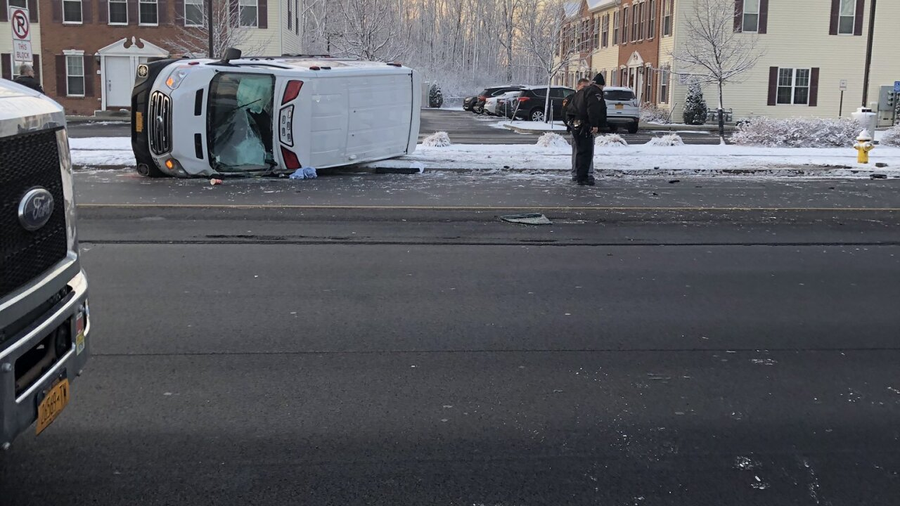 Crews looking into crash involving ambulance in Amherst