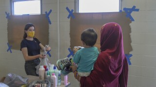 Volunteers pass out donations to Afghan guests