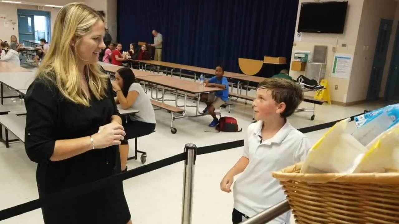 Ashton Lebron (right) with WPTV reporter Tory Dunnan