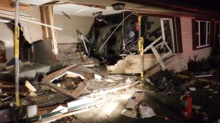 Amherst crash car into house