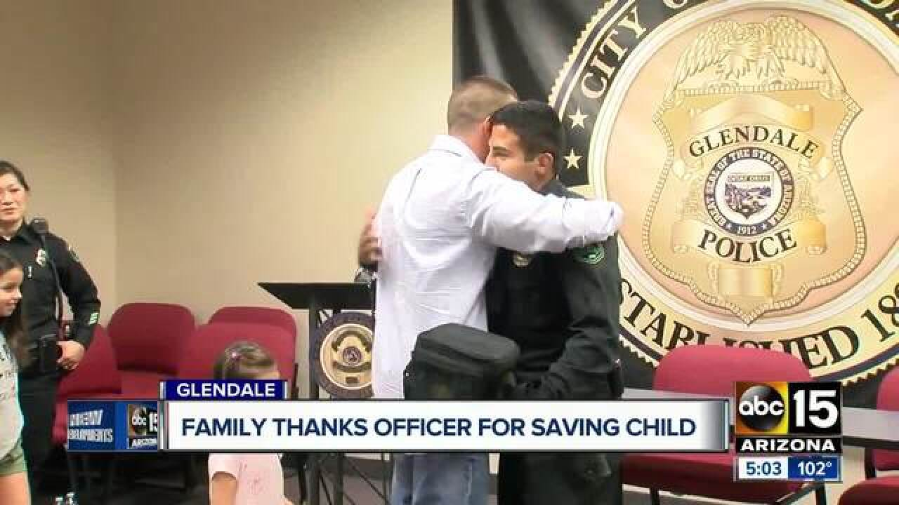 Family meets officer that helped save toddler