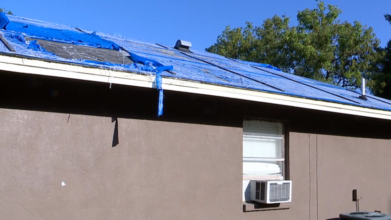 tarp on Plant City roof