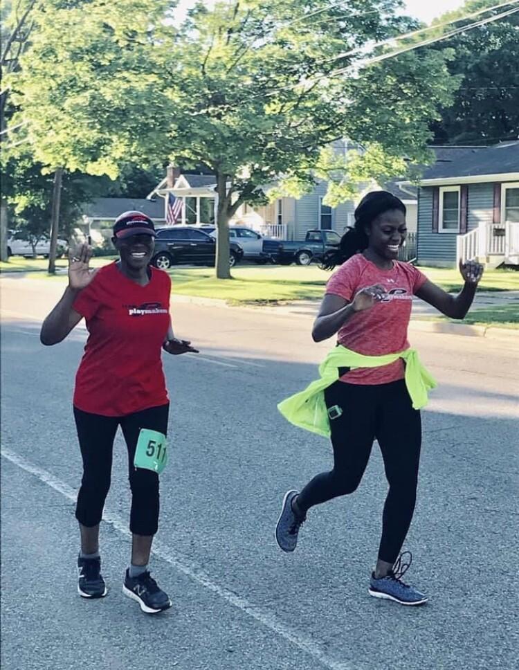 Frances Kaneene running with her daughter Tessa.