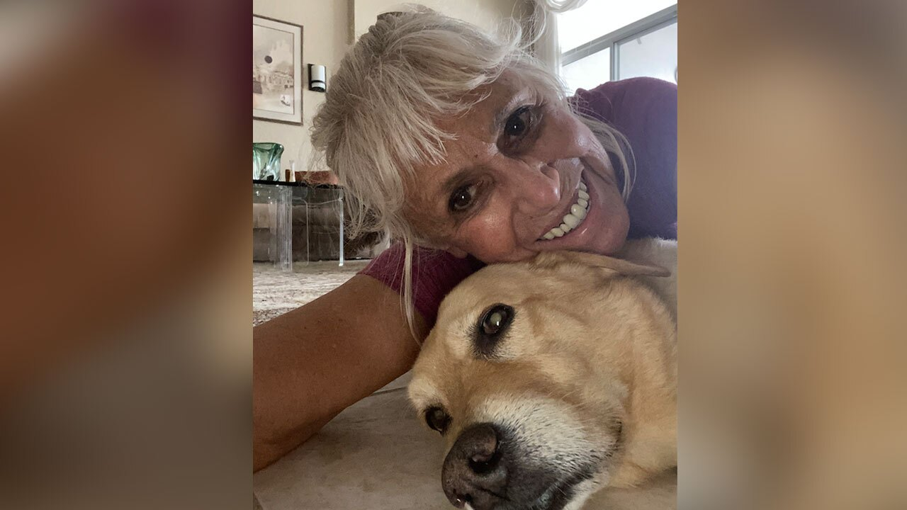 Suzan Marciano with her dog Nalu after they were attacked by an alligator