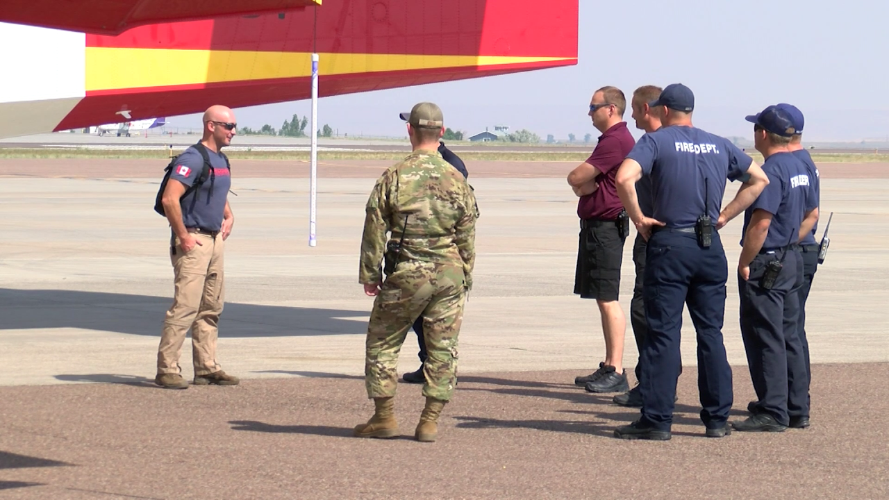 Bridger Aerospace first officer Johnny Evans with other firefighters