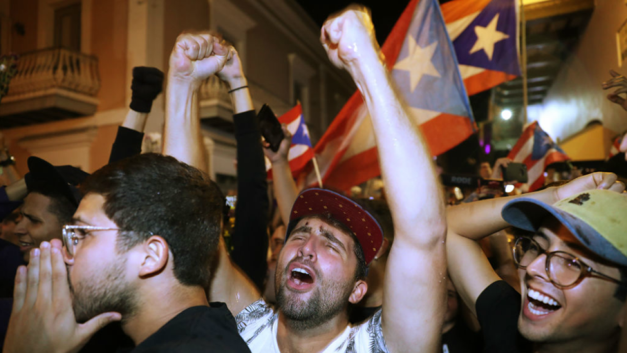 People celebrate after news that Gov. Ricardo Rossello is stepping down