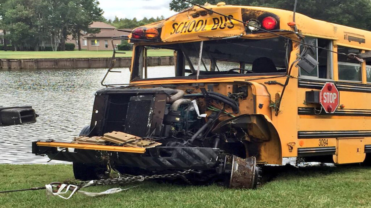 School bus in Florida overturns, lands in lake