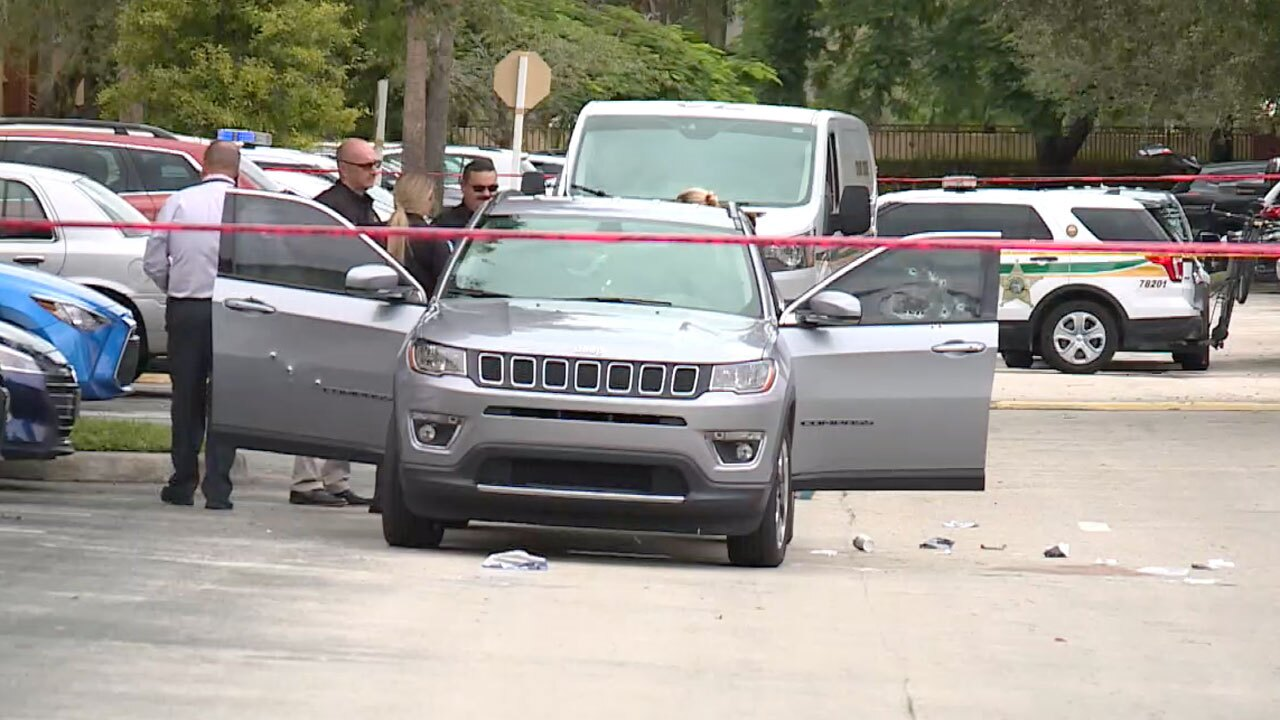 Jeep Compass with bullet holes after shooting on Summit Pines Boulevard on Sept. 22, 2021.