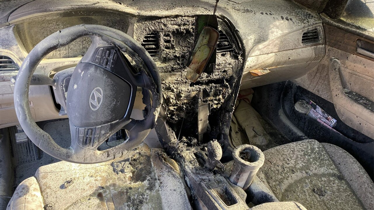Woman escapes after car's console suddenly catches fire in Delray Beach